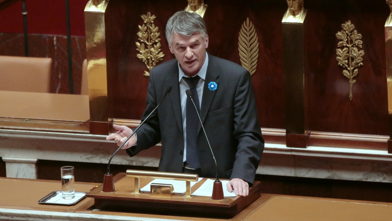 French center-right UDI (Union of Democrats and Independents) party member of Parliament Philippe Folliot speaks during a debate ahead of a parliamentary vote on whether to continue airstrikes in Syria, at the French National Assembly in Paris on November 25, 2015.