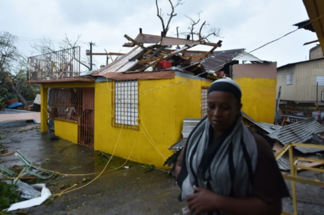 Residents of San Juan deal with damage to their homes