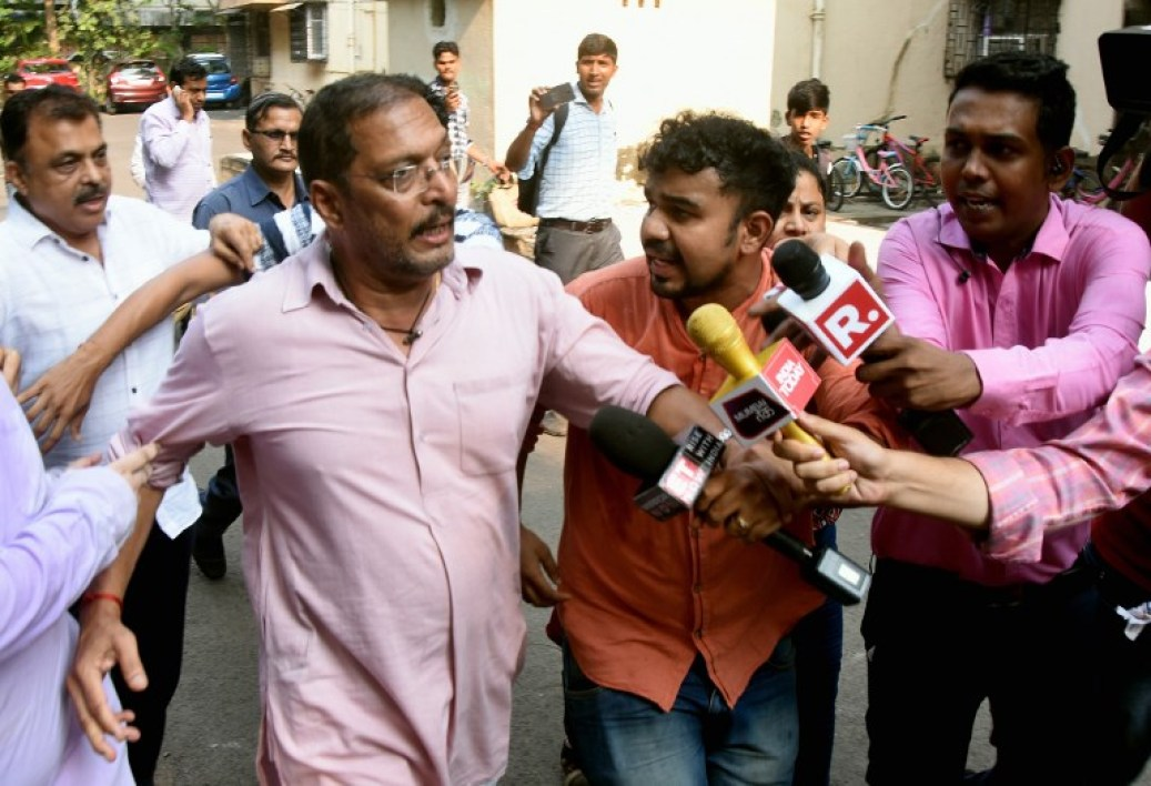 Indian Bollywood actor Nana Patekar is mobbed by the media as he leaves after making a statement outside his home in Mumbai on October 8, 2018. Indian actress Tanushree Dutta, whose recent public account of alleged sexual harassment by Patekar has sparked an outpouring of similar #MeToo accounts across the country filed a formal complaint.