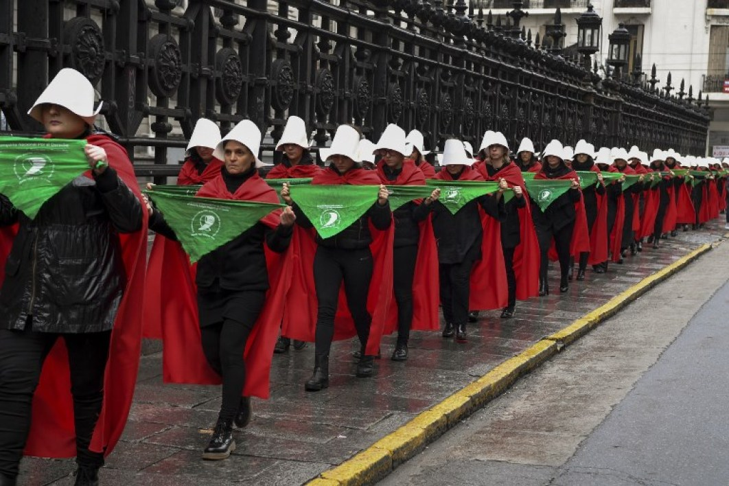 "Activists in favour of the legalization of abortion disguised as characters from Canadian author Margaret Atwood's feminist dystopian novel ""The Handmaid's Tale"", display green headscarves as they perform outside the National Congress in Buenos Aires, Argentina, on July 25, 2018. Argentina's Senate will vote on abortion bill to legalize elective abortions within the first 14 weeks of pregnancy on August 8th .The bill was approved by the lower chamber of Congress on June 14th."