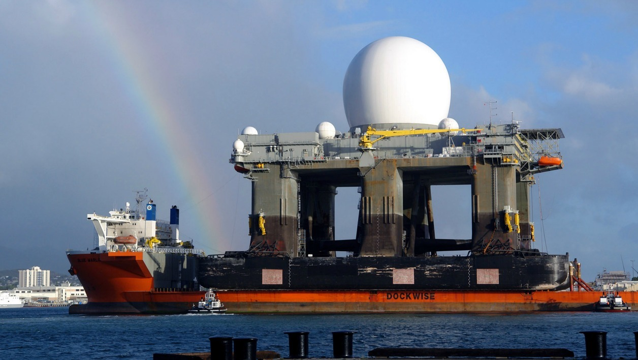 The heavy lift vessel MV Blue Marlin enters Pearl Harbor, Hawaii 09 January 2006 with the Sea Based X-Band Radar (SBX) aboard after completing a 15 000-mile (24100km) journey from Corpus Christi, Texas. SBX is a combination of the world's largest phased array X-band radar carried aboard a mobile, ocean-going semi-submersible oil platform.