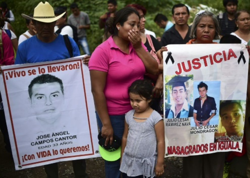 Relatives and friends of the 43 missing students from Ayotzinapa take part in a demonstration in Iguala, Guerrero State, Mexico, on September 27, 2015, to commemorate the first anniversary of their disappearance. The students, from a rur...