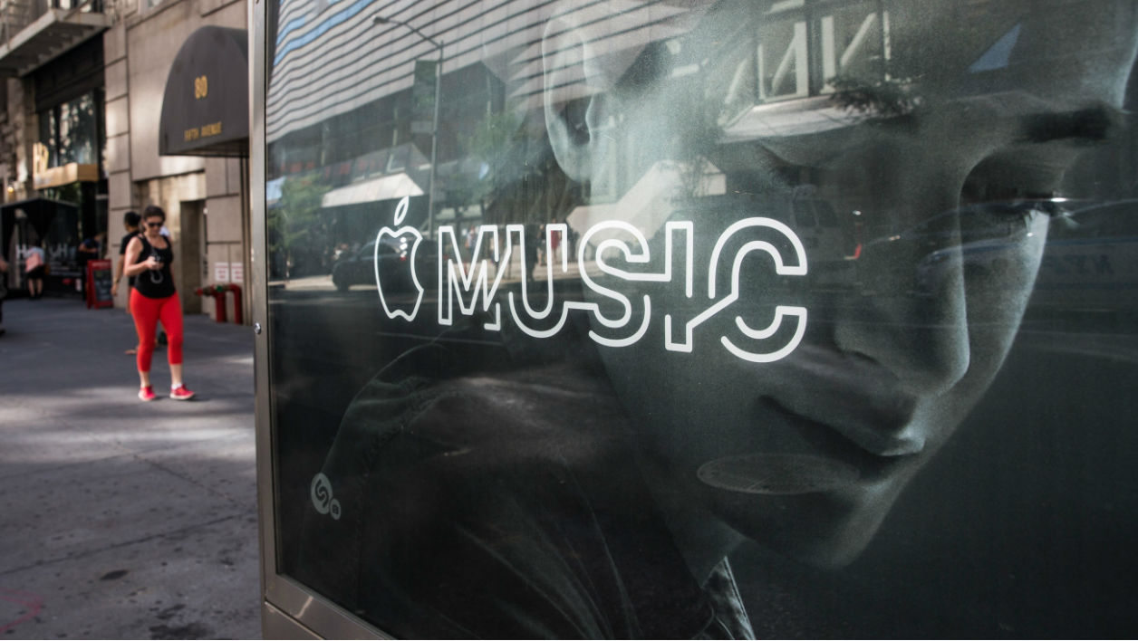 NEW YORK, NY - AUGUST 07: An advertisement for Apple Music is posted on the streets of Manhattan on August 7, 2015 in New York City. After launching in June Apple announced it has attracted 11 million users during its trial period.
