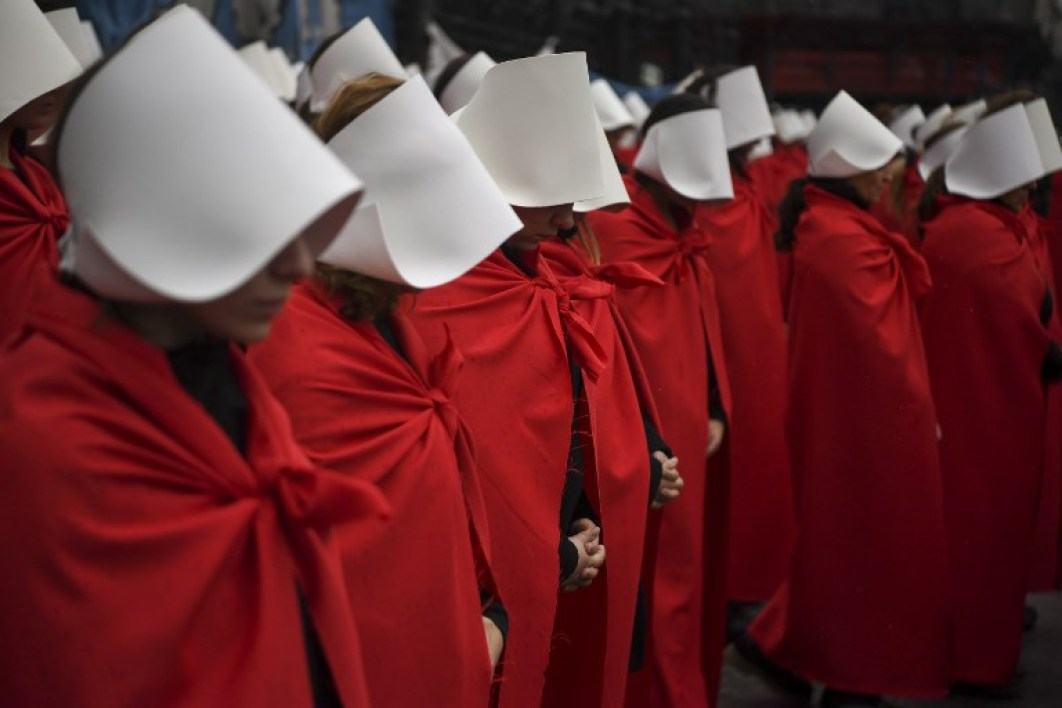 "Activists in favour of the legalization of abortion disguised as characters from Canadian author Margaret Atwood's feminist dystopian novel ""The Handmaid's Tale"", perform outside the National Congress in Buenos Aires, Argentina, on July 25, 2018. Argentina's Senate will vote on abortion bill to legalize elective abortions within the first 14 weeks of pregnancy on August 8th .The bill was approved by the lower chamber of Congress on June 14th."