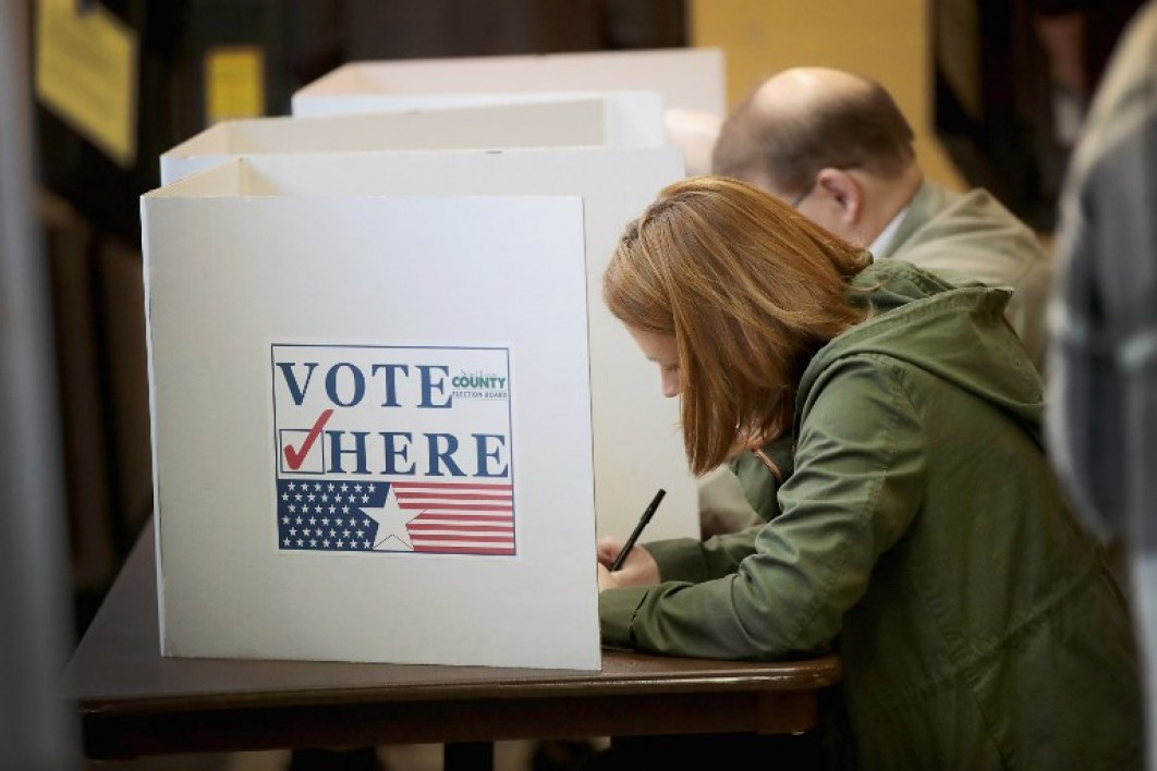 Voters cast ballots at a polling place on November 6, 2018 in Kirkwood, Missouri. Voters across the country are casting ballots in a midterm election that couuld change the ballance of both the U.S. House and Senate. Scott Olson/Getty Images/AFP  SCOTT OLSON / GETTY IMAGES NORTH AMERICA / AFP