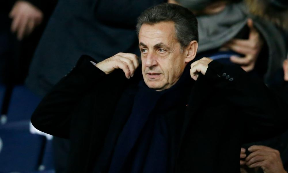 French former president Nicolas Sarkozy attends the French Cup round of 16 football match between Paris Saint-Germain (PSG) and Guingamp (EAG) at the Parc des Princes stadium in Paris on January 24, 2018.  CHARLY TRIBALLEAU / AFP