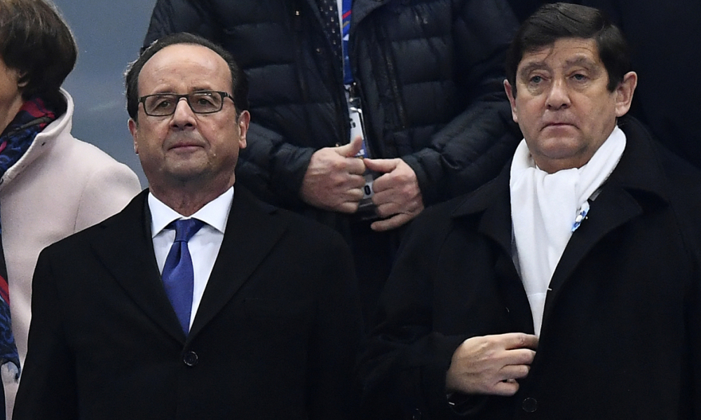 French President Francois Hollande (L) and French Minister Youth Affairs and Sports Patrick Kanner hold a minute of silence to mark the one-year anniversary of the November 13 Paris attacks ahead of the 2018 World Cup group A qualifying football match between France and Sweden at the Stade de France in Saint-Denis, north of Paris, on November 11, 2016.  FRANCK FIFE / AFP