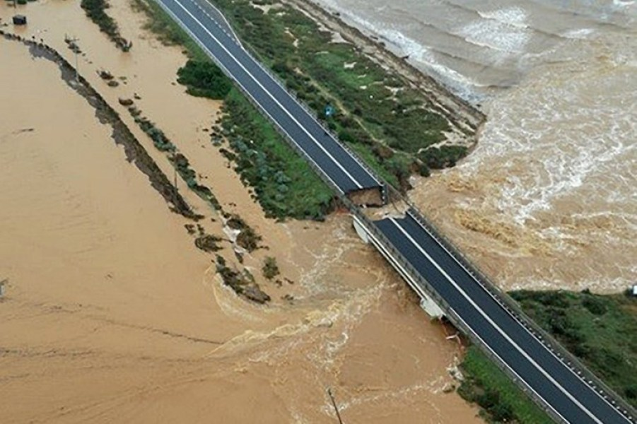This handout aerial picture taken and released by the Guardia di Finanza, the Italian government's law enforcement agency, on October 10, 2018 shows a road bridge that collapsed after torrential rain caused a river to break its banks in Capoterra, near Cagliari in Sardinia.  Handout / Guardia di Finanza press office / AFP