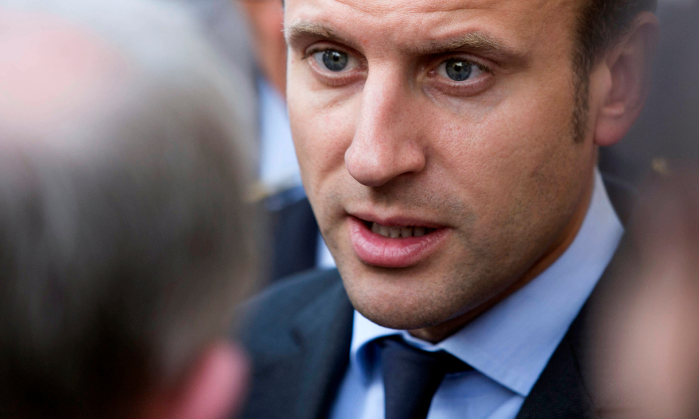 French Economy and Industry minister Emmanuel Macron speaks with inhabitants on June 7, 2016 as he visits Souppes-sur-Loing, after the city was flooded following heavy rainfalls. Across Europe, at least 17 people have been killed in floods caused by pounding rains that have trapped people in their homes and forced rescuers to navigate swamped streets in lifeboats.  GEOFFROY VAN DER HASSELT / AFP