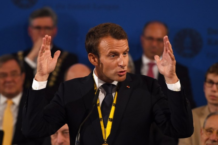 "France's President Emmanuel Macron gives a speech after receiving the Charlemagne prize during the award ceremony on May 10, 2018 in Aachen, western Germany. French President Emmanuel Macron received the prestigious Charlemagne Prize for his ""contagious enthusiasm"" for strengthening EU cohesion and integration."
