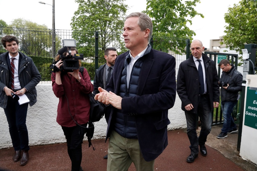Former French presidential election candidate for the right-wing Debout la France (DLF) party Nicolas Dupont-Aignan leaves after voting at a polling station in Yerres, southern Paris, on May 7, 2017, during the second round of the French presidential election.  FRANCOIS GUILLOT / AFP