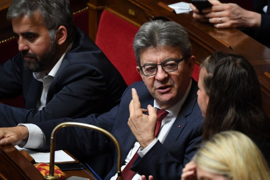 French leftist La France Insoumise (LFI) party's leader and member of Parliament Jean-Luc Melenchon (C) chats with a fellow member during an extraordinary session at the French National Assembly held for the election of the new President of the French National Assembly in Paris on September 12, 2018.  Eric FEFERBERG / AFP