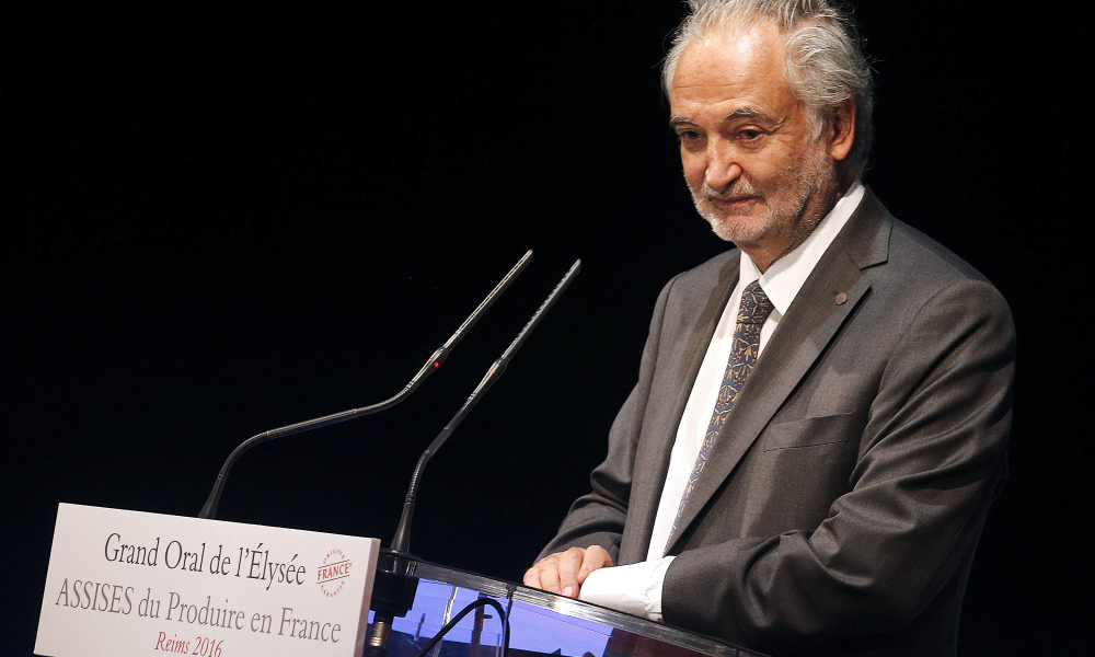 """French economist and President of the Foundation Planet Positive Jacques Attali delivers a speech during a meeting called """"Assises du Produire en France"""" to promote the increased production of, and reliance on domestic produce in Reims, on September 9, 2016.  FRANCOIS NASCIMBENI / AFP"""