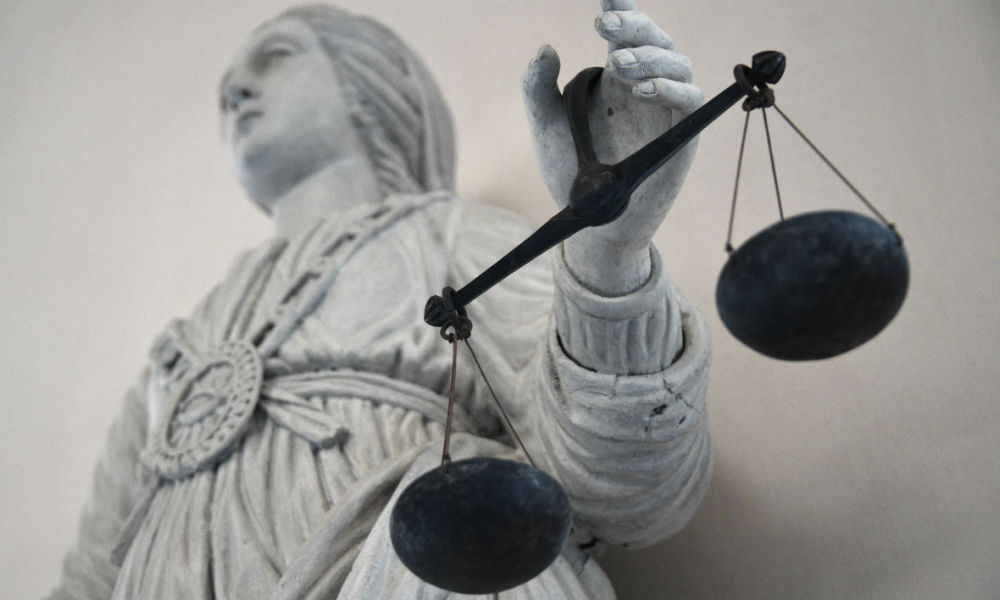 A picture taken on May 19, 2015 at Rennes' courthouse shows a statue of the goddess of Justice balancing the scales. AFP PHOTO / DAMIEN MEYER  DAMIEN MEYER / AFP