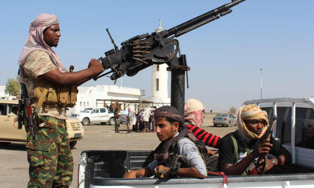 Forces loyal to the Saudi-backed Yemeni president stand on the back an armed vehicle on a road leading to the entrance of Abyan province as they take part in an operation to drive Al-Qaeda fighters out of the southern provincial capital, on April 23, 2016. Yemeni forces backed by air power from the Saudi-led Arab coalition launched an operation in Abyan province as they advanced towards Zinjibar and the neighbouring town of Jaar, military sources said. Soldiers reached Al-Kud, five kilometres (three miles) south of Zinjibar where they clashed with Qaeda militants, while coalition Apache helicopters targeted extremist positions in the vicinity, according to the officials. Twelve Al-Qaeda militants and three soldiers died in the fighting, a military official said. Government forces last week expelled militants of the jihadist network's local branch -- Al-Qaeda in the Arabian Peninsula -- from Huta, the provincial capital of Lahj, as part of a widespread operation to secure southern provinces. Coalition-backed forces have driven militants out of Aden, the southern city declared by Hadi as temporary capital after Shiite Huthi rebels stormed Sanaa in September 2014. The Arab coalition launched a military operation in support of Hadi in March last year after rebels advanced on his refuge in Aden and forced him to flee to Riyadh.