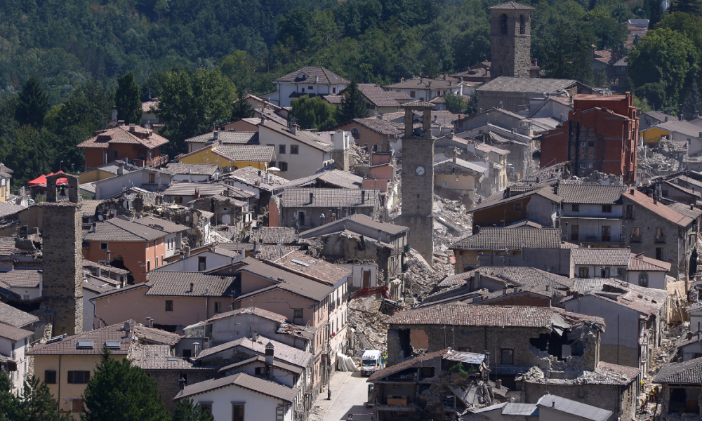 Partial view of the damaged central Italian village of Amatrice, taken on August 25, 2016, a day after a 6.2-magnitude earthquake struck the region killing some 247 people. The death toll from a powerful earthquake in central Italy rose to 247 on August 25, 2016 amid fears many more corpses would be found in the rubble of devastated mountain villages. Rescuers sifted through collapsed masonry in the search for survivors, but their grim mission was clouded by uncertainty about exactly how many people had been staying in communities closest to the epicentre of the quake of August 24.  FILIPPO MONTEFORTE / AFP