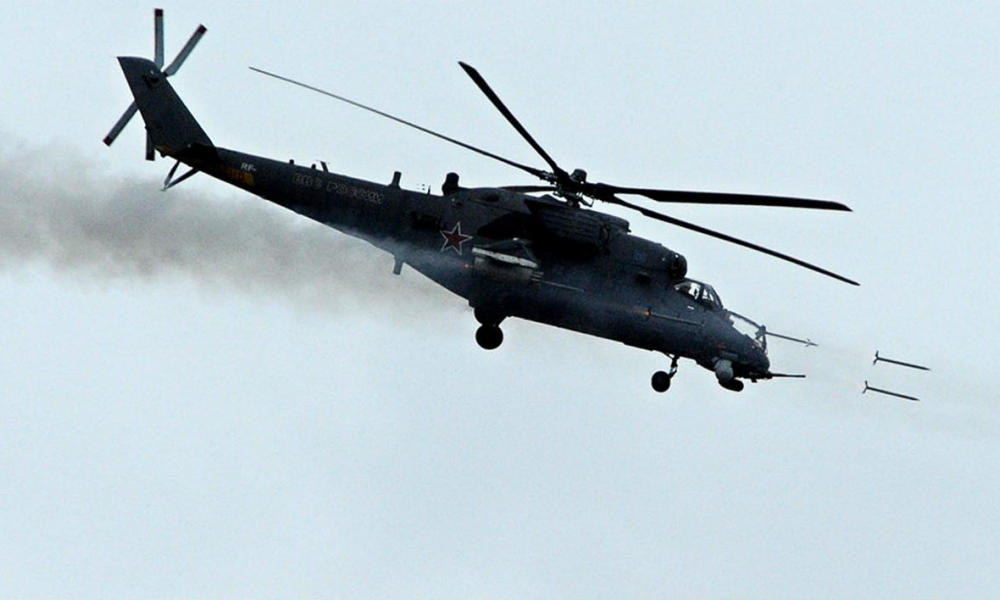A Russian MI-28 military helicopter shoots missiles on October 2, 2014 during the Indra-2014 joint Russian-Indian tactical military exercises at the Prudboy firing ground, outside Russia's southern city of Volgograd. Troops from both countries are sharing experience and training for joint actions to guard important state facilities, escort convoys and neutralize illegal armed formations.