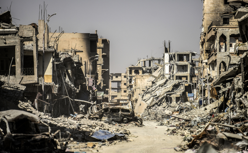 A picture taken on October 21, 2017 shows a general view of heavily damaged buildings in Raqa, after a Kurdish-led force expelled the Islamic State group from the northern Syrian city. For three years, Raqa saw some of IS's worst abuses and grew into one of its main governance hubs, a centre for both its potent propaganda machine and its unprecedented experiment in jihadist statehood. BULENT KILIC / AFP