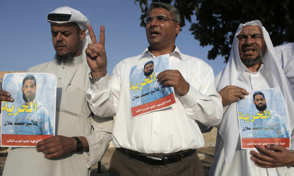 Arab-Israeli protesters hold posters of Mohammed Allan, a Palestinian prisoner who is on a long-term hunger strike, during a rally calling for his release in the southern Israeli Bedouin city of Rahat on August 18, 2015. Allan, who has been on hunger strike for the past two months, emerged from a coma on August 18 but pledged to resume fasting if Israel did not resolve his case within 24 hours, a Palestinian group said. AFP PHOTO / AHMAD GHARABLIArab-Israeli protesters hold posters of Mohammed Allan, a Palestinian prisoner who is on a long-term hunger strike, during a rally calling for his release in the southern Israeli Bedouin city of Rahat on August 18, 2015. Allan, who has been on hunger strike for the past two months, emerged from a coma on August 18 but pledged to resume fasting if Israel did not resolve his case within 24 hours, a Palestinian group said. AFP PHOTO / AHMAD GHARABLIArab-Israeli protesters hold posters of Mohammed Allan, a Palestinian prisoner who is on a long-term hunger strike, during a rally calling for his release in the southern Israeli Bedouin city of Rahat on August 18, 2015. Allan, who has been on hunger strike for the past two months, emerged from a coma on August 18 but pledged to resume fasting if Israel did not resolve his case within 24 hours, a Palestinian group said. AFP PHOTO / AHMAD GHARABLI