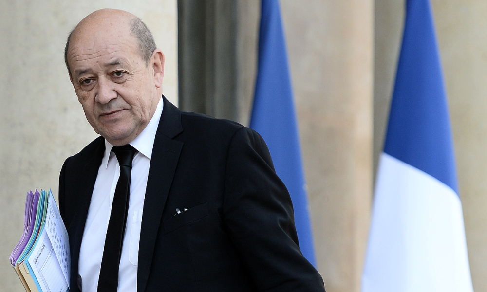 French Defence Minister Jean-Yves Le Drian arrives at the Elysee Palace to meet with French President following Brussels attacks on March 22, 2016 in Paris.  STEPHANE DE SAKUTIN / AFP