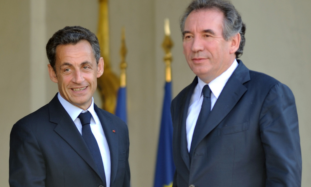 France's President Nicolas Sarkozy escorts leader of the French centrist Modem party Francois Bayrou after a meeting on June 11, 2009 at the Elysee presidential palace in Paris. AFP PHOTO ERIC FEFERBERG ERIC FEFERBERG / AFP