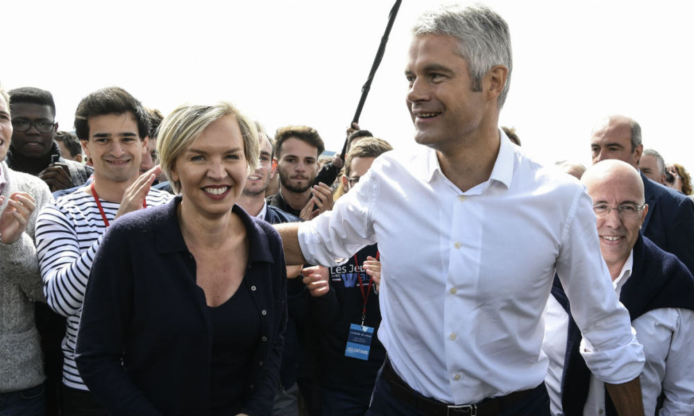 President of Auvergne-Rhone-Alpes council, Vice-President of the French right-wing Les Republicains (LR) party, and candidate for the LR presidency, Laurent Wauquiez (R), LR member of Parliament and President of the Alpes-Maritimes departmental council, Eric Ciotti (C), and Bordeaux Deputy Mayor Virginie Calmels (L), arrive at Les Etables, central France, on September 3, 2017, ahead of Wauquiez's traditional climb of the Mont Mezenc.