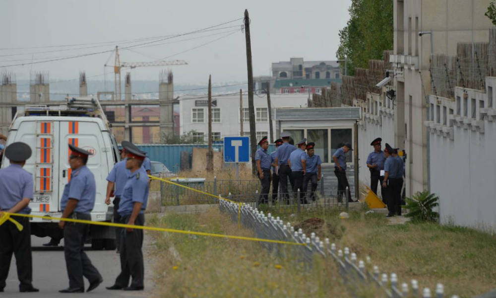 Kyrgyz police officers gather outside the Chinese embassy in Bishkek on August 30, 2016. A van driven by a suicide bomber exploded after ramming through a gate at the Chinese embassy in Kyrgyzstan on August 30, wounding three people, authorities said. Vyacheslav OSELEDKO / AFP