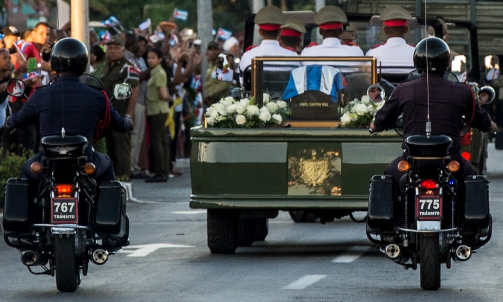 The urn with the ashes of Cuban leader Fidel Castro is taken from Revolution Square in Santiago, Cuba on December 4, 2016 to the cemetery. The ashes of late Cuban leader Fidel Castro were taken on Sunday to be laid to rest at a cemetery in the eastern city of Santiago de Cuba. JUAN BARRETO / AFP