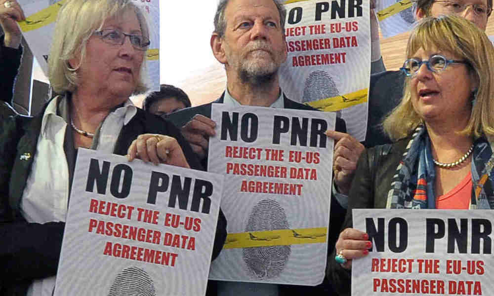 Members of European United Left/Nordic Green Left (GUE/NGL) protest against a PNR (Passenger name record) agreement with the US authorities on April 19, 2012, in front of the hemicycle of the European Parliament in Strasbourg, northeastern France. A controversial deal enabling the longterm transfer of EU air passenger data to US authorities as part of the global fight against terror was finally approved today in the European Parliament. MEPs gave their green