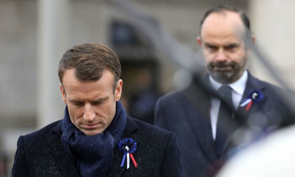 French President Emmanuel Macron (L) and French Prime Minister Edouard Philippe attend a ceremony at the Arc de Triomphe in Paris on November 11, 2018 as part of commemorations marking the 100th anniversary of the 11 November 1918 armistice, ending World War I.  ludovic MARIN / POOL / AFP