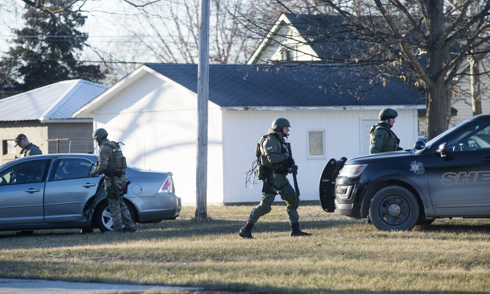MOUNT PLEASANT, MI - MARCH 02: Michigan police officials survey nearby neighborhoods as police continue to search for a suspect near Central Michigan University on March 2, 2018 in Mount Pleasant, Michigan.