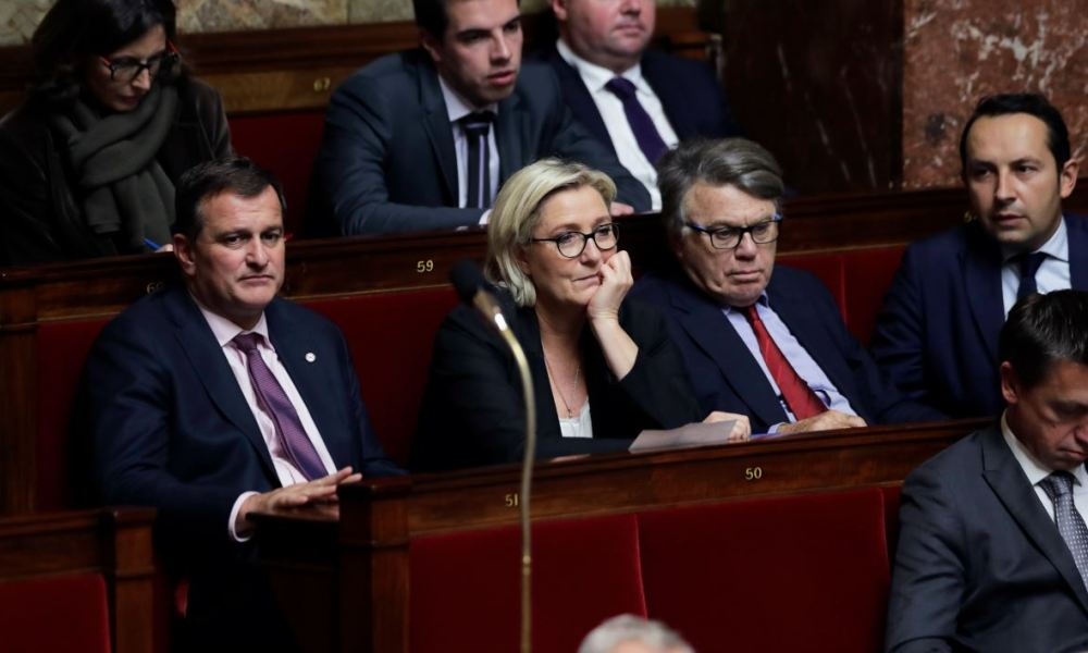 French far-right Front National (FN) party members of Parliament (Top L-R) Emmanuelle Menard, Ludovic Pajot, Bruno Bilde, (bottom L-R) Louis Aliot, FN president Marine Le Pen, Gilbert Collard and Sebastien Chenu attend a session of questions to the government at the French National Assembly in Paris on October 25, 2017.  Thomas SAMSON / AFP