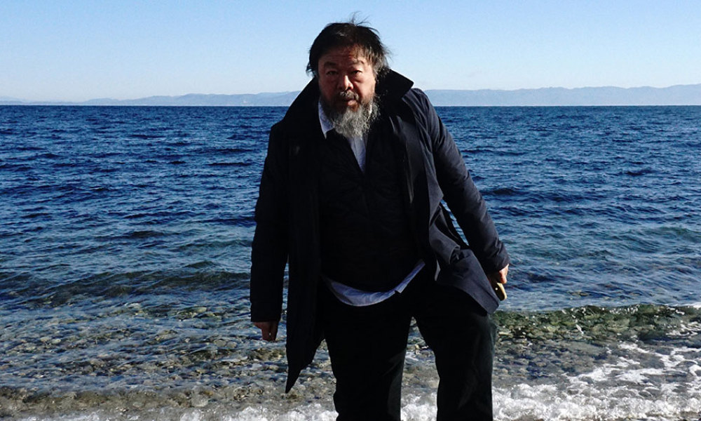 Chinese activist and artist Ai Weiwei walks on a beach near the town of Mytilene, on the Greek island of Lesbos on January 1, 2016. Chinese dissident artist Ai Weiwei paid on December 28, 2015 a holiday visit to refugees and migrants flocking to the Greek island of Lesbos, tweeting out photos and videos in appeals for their plight.