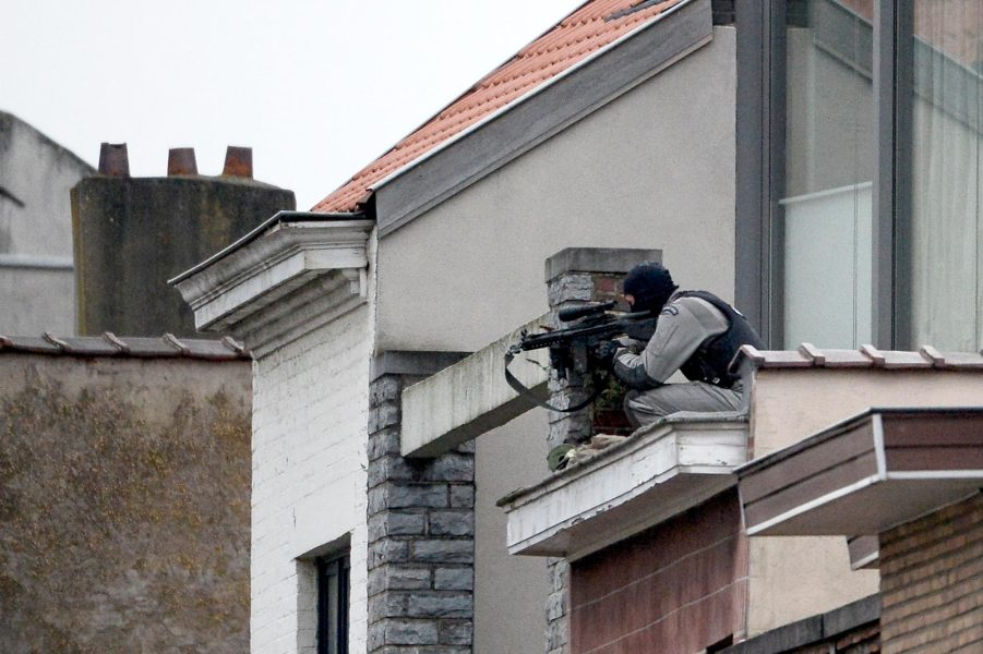 A member of the special forces takes position on a roof near the site of a shooting in the southern Forest district of Brussels on March 15, 2016. Belgian and French police launched a huge manhunt for two suspects in Brussels after gunmen opened fire, wounding three officers, during a joint anti-terror operation linked to the Paris attacks.  DIRK WAEM / Belga / AFP