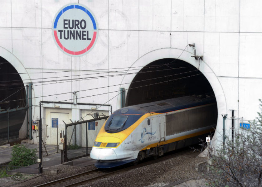 A photo taken on April 10, 2014 in Coquelles, northern France shows a Eurostar train coming out of the Channel Tunnel. A migrant died on July 7, 2015 trying to reach Britain through the Channel Tunnel, a French official in the Pas-de-Calais region said. One of the six sections of the tunnel was closed for investigation and it was not yet clear how the migrant had died. AFP PHOTO / DENIS CHARLET