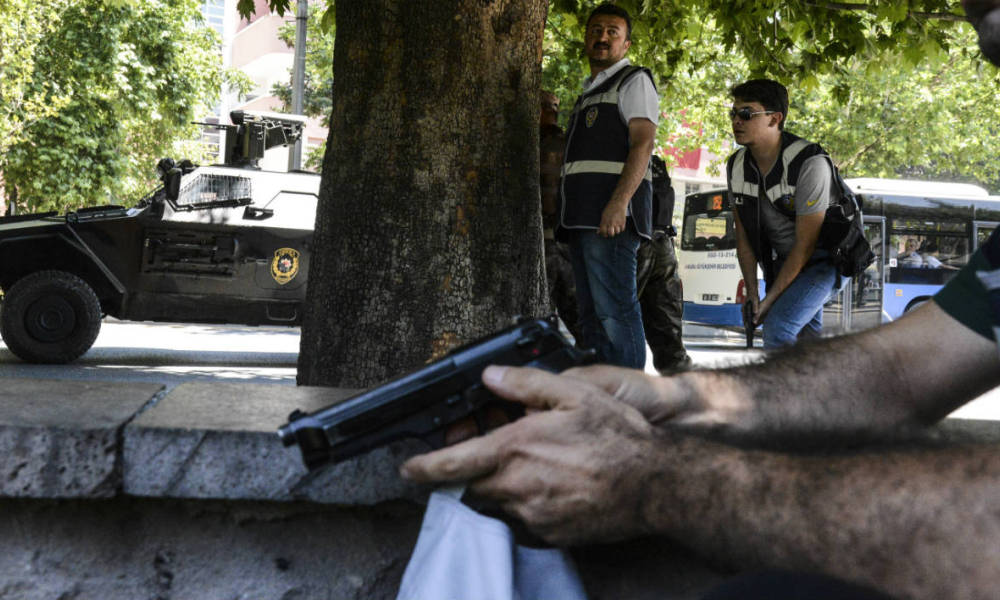 Turkish police officers operate in front of the courthouse on July 18, 2016, in Ankara. Turkey has detained more than 7,500 suspects involved in the coup plot seeking to oust the government, the prime minister said on July 18, 2016. Giving a new toll, he said 208 people were killed by the coup bid, including 145 civilians, 60 police and three soldiers. 1,491 were wounded, he added, In addition, the authorities have said more than 100 coup plotters were killed.