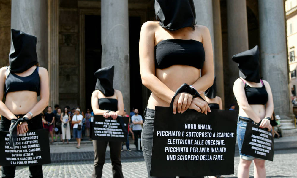 Amnesty International activists perform a flash mob on July 13, 2016, in Rome's Pantheon square to remember late Italian student Giulio Regeni and other victims following their last report. The badly mutilated body of Regeni, a 28-year-old Cambridge University PhD student, was found out on February 4, 2016 in Cairo. Italian media and diplomats say he was killed by the security services but Egypt denies the claims.