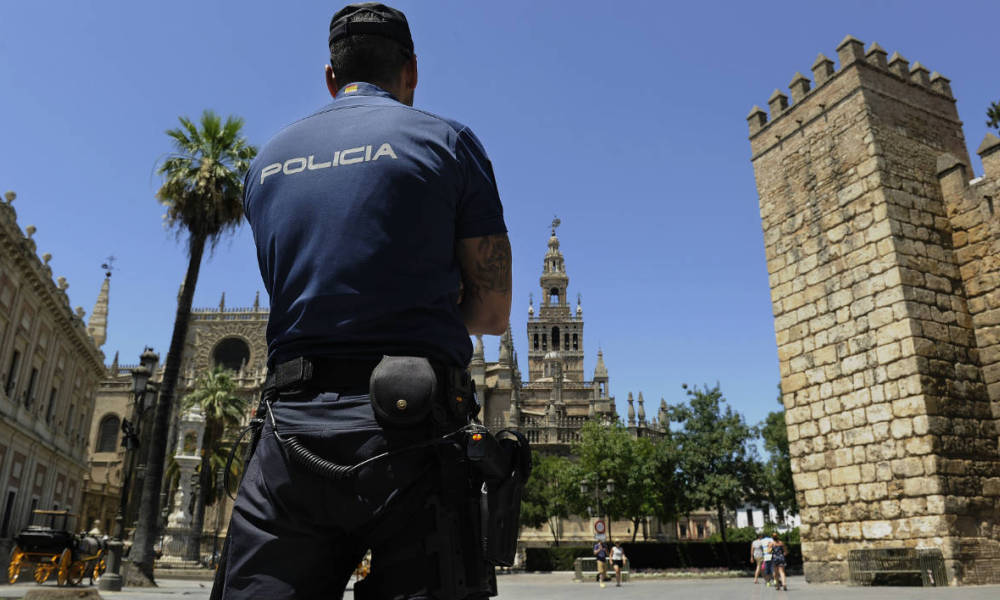 Spanish National Police patrol outside the Alcazar of Seville, in Sevilla on July 8, 2016 on the eve of the US President's official visit to Spain.  CRISTINA QUICLER / AFP