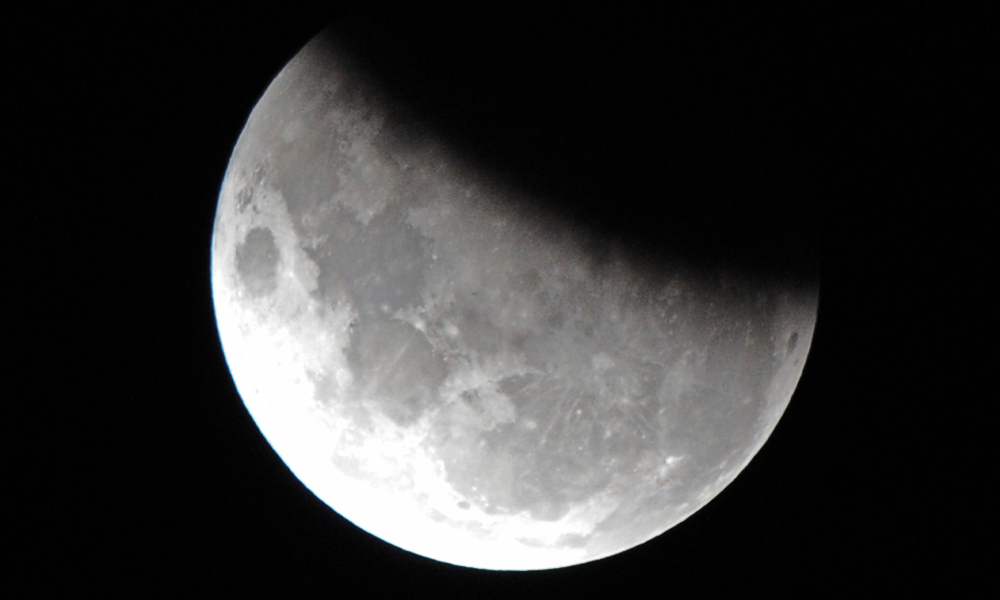 The moon is 37 per cent obscured by the Earth's shadow during the partial lunar eclipse above Sydney on June 4, 2012. A partial eclipse occurs when Earth slides between the Moon and the Sun, casting a shadow over its satellite. AFP PHOTO / Torsten BLACKWOOD TORSTEN BLACKWOOD / AFP