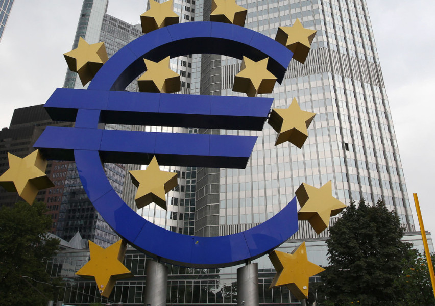 The EURO logo is seen outside the European Central Bank (ECB) in Frankfurt/Main, western Germany, on September 4, 2014. The European Central Bank surprised financial markets by paring back its key interest rates to new all-time lows to ward off deflation, and it also cut growth forecasts. AFP PHOTO / DANIEL ROLAND