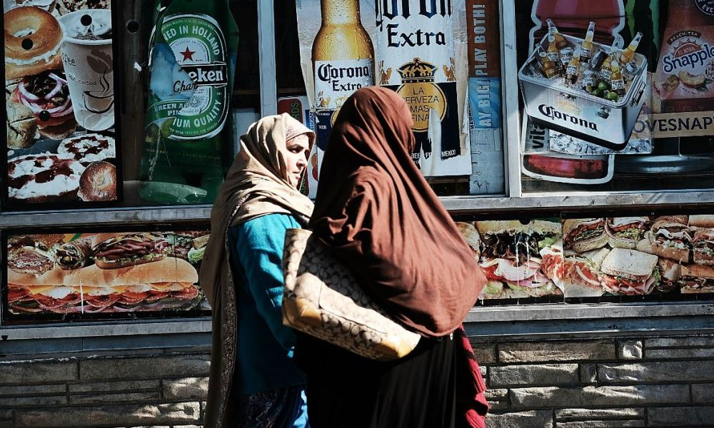 NEW YORK, NY - OCTOBER 18: Muslim women walk along Coney Island Avenue on October 18, 2017 in New York City. Coney Island Avenue, a road that runs north-south for a distance of roughly five miles, winds through some of the most diverse neighborhoods in Brooklyn.