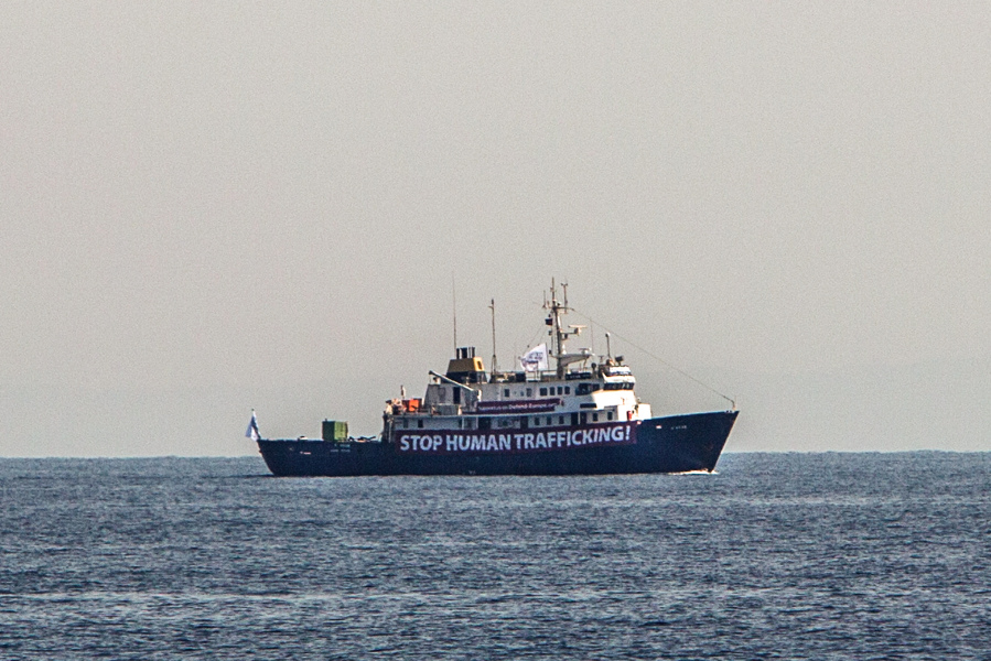 A banner that reads, 'Stop Human Trafficking' is attached to the side of the C-Star as it saild in the Mediterranean Sea, 20 nautic miles off the Libyan coast. Angelos Tzortzinis / AFP