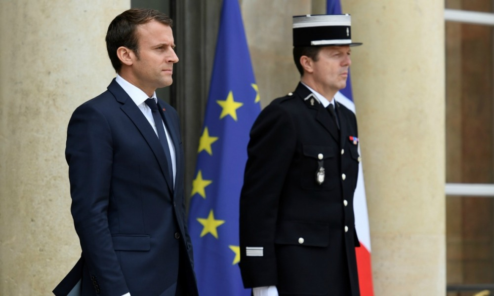 French president Emmanuel Macron (L) waits for the arrival of Denmark's Prime minister Lars prior to a meeting, on June 7, 2017 at the Elysee palace in Paris.  bertrand GUAY / AFP