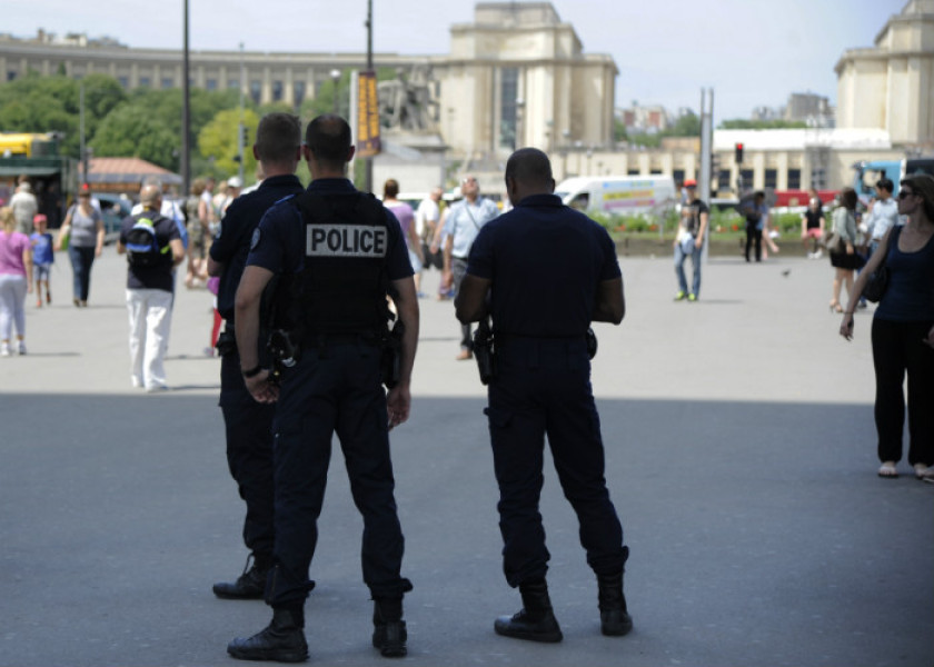 """Policemen patrol under the Eiffel Tower on June 26, 2015 in Paris, after an attack defined as """"Islamist terrorism"""" by the French prime minister hit a factory earlier in the day in the Rhone-Alpes region. French president Francois Hollande announced on June 26 he was raising the security level to """"attack"""" -- the highest possible -- in the region in which a gas factory was assaulted earlier in the day. AFP PHOTO / THOMAS OLIVA"""