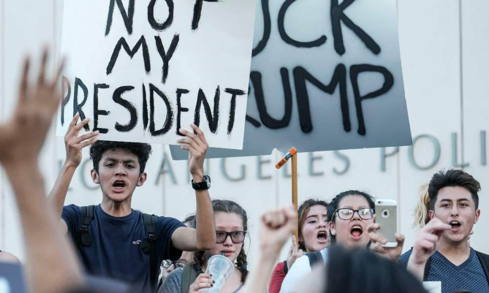 Demonstrators rally outside Los Angeles City Hall to protest the presidential election win President-elect Donald Trump in Los Angeles, California, on November 9, 2016.  RINGO CHIU / AFP