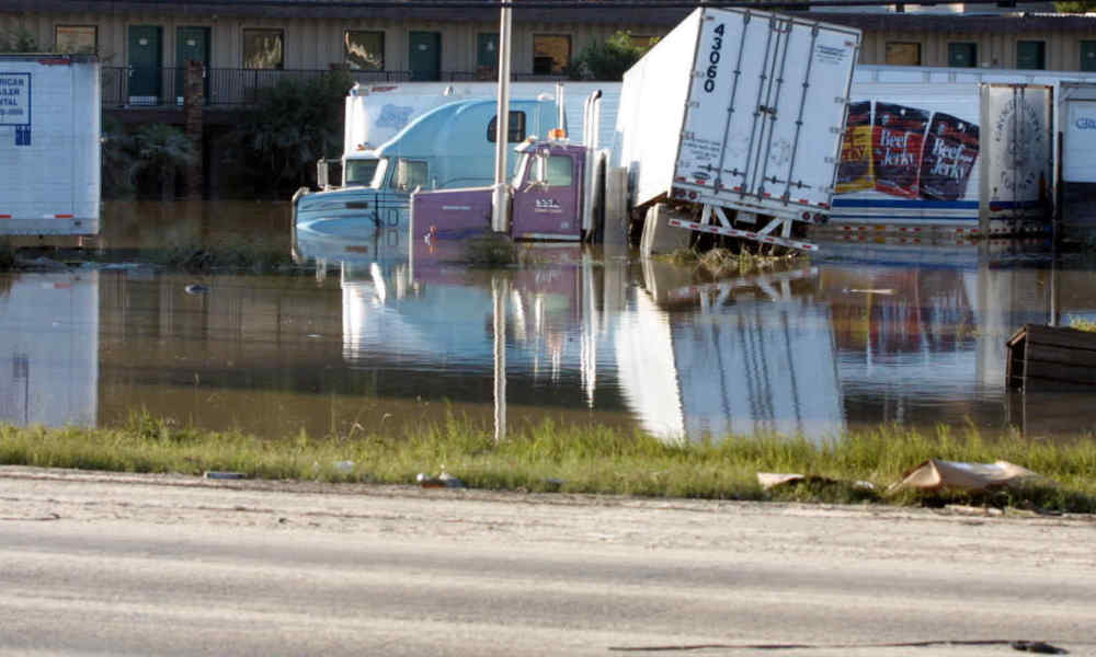 Eighteen wheeler trucks are swamped 10 June 2001 in a motel parking lot off of Interstate 10 in Houston, Texas, following heavy rains from tropical storm Allison. Thousands of people in Texas and Louisiana are temporarily homeless after being forced to flee flooding caused by four days of torrential rains. The American Red Cross blamed at least seven deaths on the violent weather, the aftermath of tropical storm Allison. AFP PHOTO/James NIELSEN