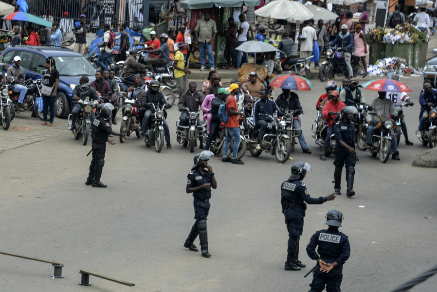 Cameroon police forces patrol at a traffic intersection in Douala on October 21, 2017. Police patrols were seen from the early hours on some streets of the city of Douala, the economic capital of Cameroon, to prevent the holding of a demonstration by the Social Democracy Front (SDF) which has been banned by authorities.  STR / AFP
