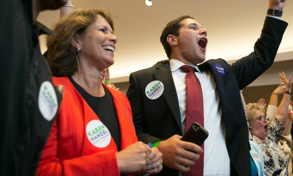 ATLANTA, GA - JUNE 20: Handel supporters including (left to right) Amy Kaye and Adam Kaye cheer for early results in favor of Georgia's 6th Congressional district Republican candidate Karen Handel during an election party at the Hyatt Regency at Villa Christina on June 20, 2017 in Atlanta, Georgia.