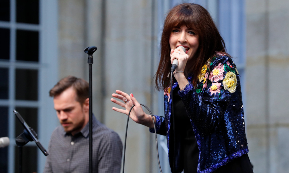 French singer Nolwenn Leroy performs for the Fete de la Musique at the Hotel Matignon in Paris on June 21, 2016. France's annual summer solstice music extravaganza -- a party it has exported across the globe -- will be slightly muted this year amid terror fears and the Euro 2016 football tournament.