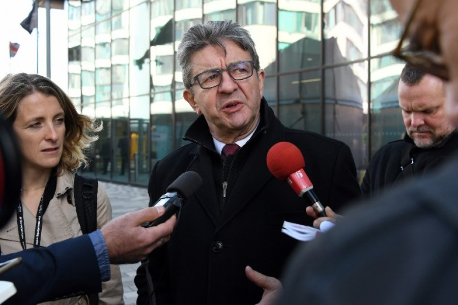 Jean-Luc Melenchon, leader of La France Insoumise (LFI) party speaks to members of the medai following his meeting with Britain's opposition Labour party leader Jeremy Corbyn, on the sidelines of the Labour Party Conference in Liverpool, north west England on September 24, 2018.  Paul ELLIS / AFP